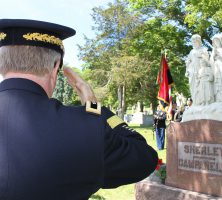 Very Reverend Donald L. Rutherford- Chaplain, Major General, U.S. Army, Retired saluting the gravesite.