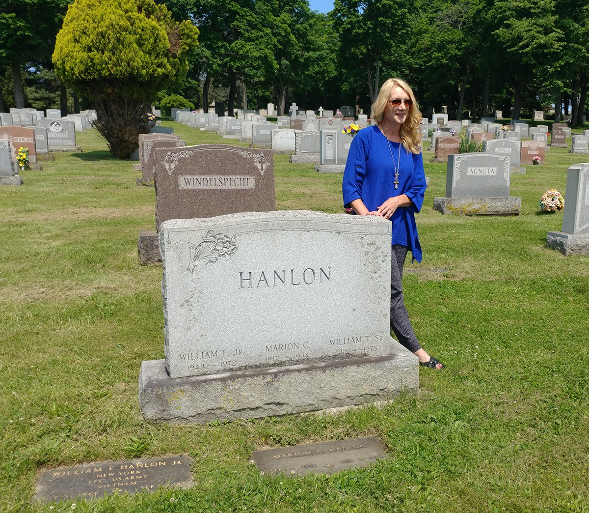 Historian Kelly Grimaldi at Marion Hanlon's gravesite.