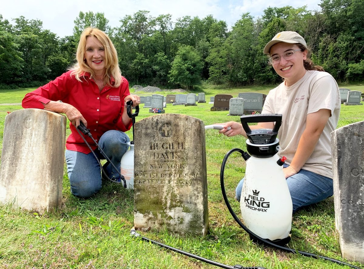 Albany Diocesan Cemeteries Historian Kelly Grimaldi and our summer intern Maria Santacrose working on one of the veteran stones at St. Mary's.