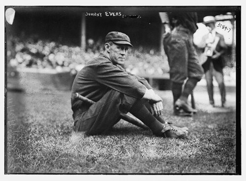 Johnny Evers sitting in field