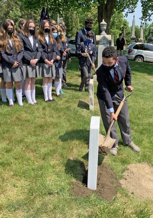 St. Gregory's student fills in around Private Connors gravestone