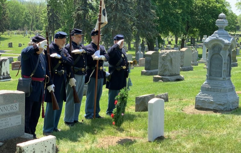 Members of the 125th NY Regent Association, Inc. salute Private Connors gravesite